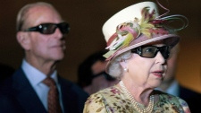 Queen Elizabeth II, right, and Prince Phillip wear 3-D glasses as they view a screening at Pinewood Toronto Studios on Monday, July 5, 2010. (Chris Young / THE CANADIAN PRESS)
