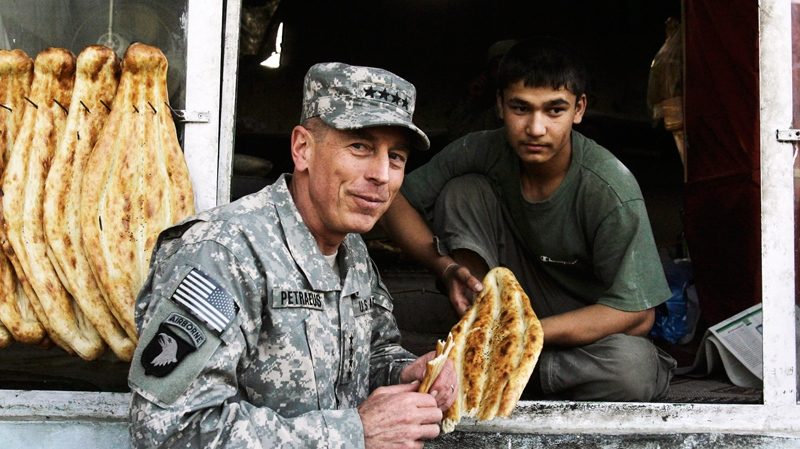 Gen. David Petraeus, the new commander of U.S. and NATO forces in Afghanistan, eats bread at a bakery in Kabul, Afghanistan, on Monday, July 5, 2010. (AP / Ahmad Massoud)