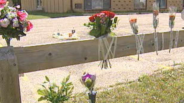 Friends and family left flowers at the site where Kaila Latoya Tran, 26, was murdered in Winnipeg.