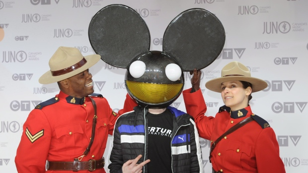 Deadmau5 poses on the red carpet at the Juno Awards in Ottawa, Sunday April 1, 2012.