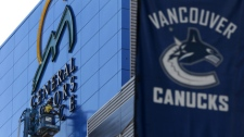 Workers begin removing the General Motors Place sign off the arena which is home to the NHL's Vancouver Canucks after it was renamed Rogers Arena in Vancouver, B.C., on Tuesday July 6, 2010. The arena had been called GM Place since it opened in 1995. (CP/Darryl Dyck)