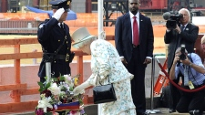 Queen Elizabeth II dedicates a memorial wreath at the site of the Sept. 11 attacks, July 6, 2010 in New York. (AP / Stephen Chernin)
