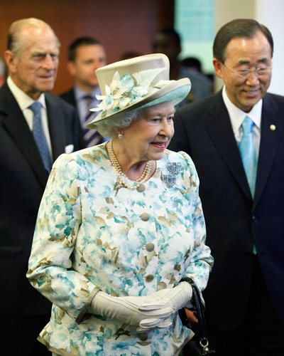 Pictured from left, Prince Philip, Duke of Edinburgh, follows Queen Elizabeth II and United Nations Secretary-General Ban Ki-moon as they enter the United Nations headquarters, Tuesday, July 6, 2010. (AP / Stuart Ramson)