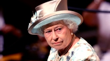 Queen Elizabeth II waits to speak at United Nations Headquarters, Tuesday, July 6, 2010. (AP / Seth Wenig)