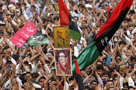 Supporters of former Pakistani Prime Minister Benazir Bhutto rally during their leaders election campaign in Larkana, Pakistan Sunday, Dec. 23, 2007. (AP Photo/Shakil Adil)
