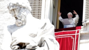 Pope Benedict XVI delivers his blessing during the Angelus prayer from his studio overlooking St. Peter's square at the Vatican, in this 2012 file photo. (AP / Riccardo De Luca)