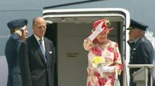 Queen Elizabeth waves goodbye as she and Prince Philip board a plane to New York City at Pearson airport on Tuesday, July 6, 2010.