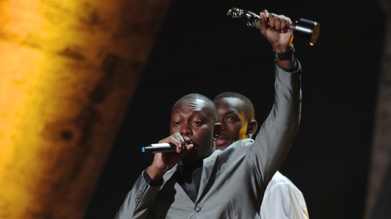 In this Feb. 16, 2010 file photo, Dizzee Rascal holds up the award of British Male Solo Artist during the Brit Awards 2010 at Earls Court exhibition center in London. (AP Photo/Andy Paradise)