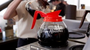 A server pours a cup of coffee at the Tim Hortons' AGM in Toronto on Thursday, May 10, 2012. (Chris Young / THE CANADIAN PRESS)