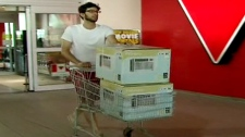 A man buys two air conditioners to cope with the extreme heat.