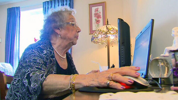 A senior uses a computer in her home in this undated photo from video.