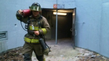 A firefighter leaves the Emergency exit of Spadina Subway following this afternoon's emergency on Wednesday, July 6, 2010. (Keith Hanley / CTV News)