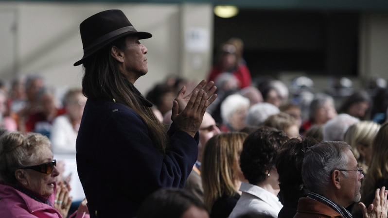 Residential school survivor Leonard James, from the Cowichan Valley, applauds during the Truth and Reconciliation Commission of Canada gathering in Victoria, B.C. in April 2012. (Chad Hipolito / THE CANADIAN PRESS)