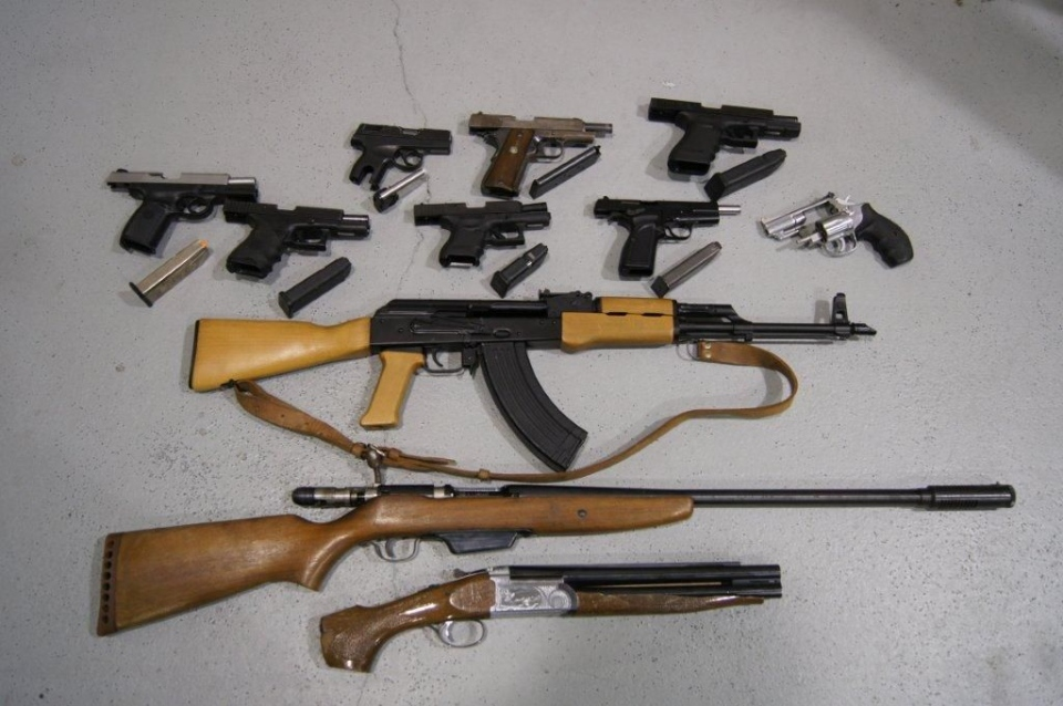 This file photo shows guns seized by Toronto Police on June 24, 2012. On Tuesday Ontario's highest court begins hearing a number of landmark cases on mandatory minimum sentences for gun crimes