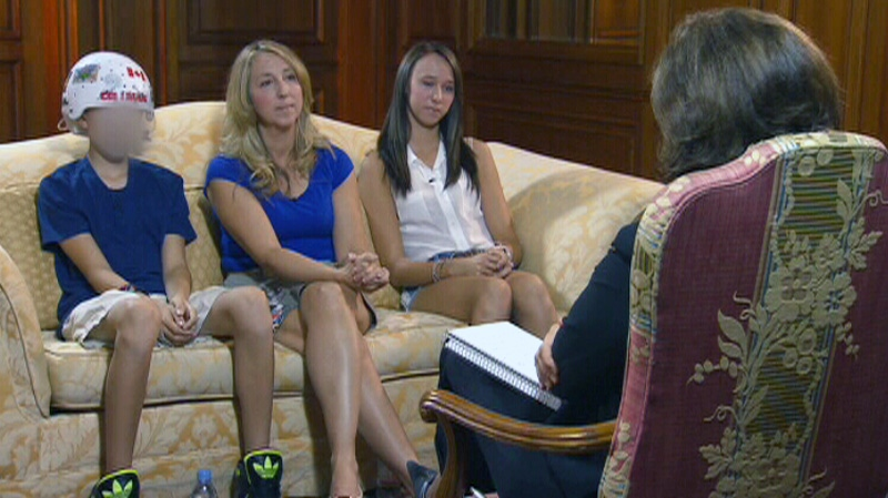 Lisa LaFlamme speaks with one of the victims of the shooting at the Eaton Centre in Toronto.
