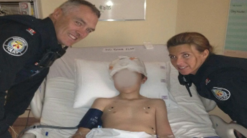 The 13-year-old victim lies in a hospital bed after being shot at Toronto Eaton Centre, Saturday, June 2, 2012.