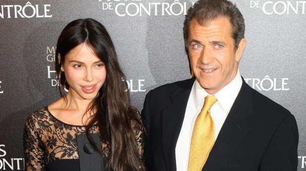 Mel Gibson and Oksana Grigorieva arrive at the 'Edge Of Darkness' premiere in Paris, Feb. 4, 2010. (AP / Jacques Brinon)