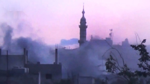 In this image made from amateur video released by the Shaam News Network and accessed Monday, June 25, 2012, smoke rises from buildings following purported shelling in Talbeesa, Homs, Syria. (AP / Shaam News Network via AP video)