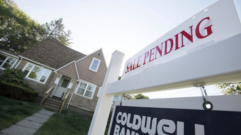 In this April 26, 2012, file photo, a sign advertises a pending residential real estate sale in Framingham, Mass. (AP Photo/Bill Sikes)