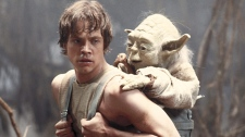 In this 1980 publicity image originally released by Lucasfilm Ltd., Mark Hamill as Luke Skywalker and the character Yoda appear in this scene from 'Star Wars Episode V: The Empire Strikes Back.'
