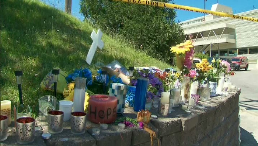 A memorial grows for the victims of a shopping mall collapse in Elliot Lake on Tuesday, June 26, 2012.
