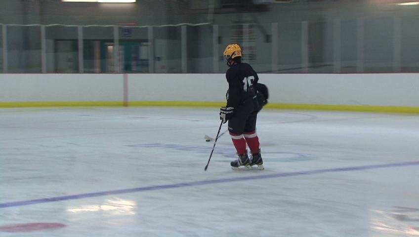 Thirteen-year-old Aidan Munn is playing hockey again after he was diagnosed with viral encephalitis and fell into a coma in 2010.