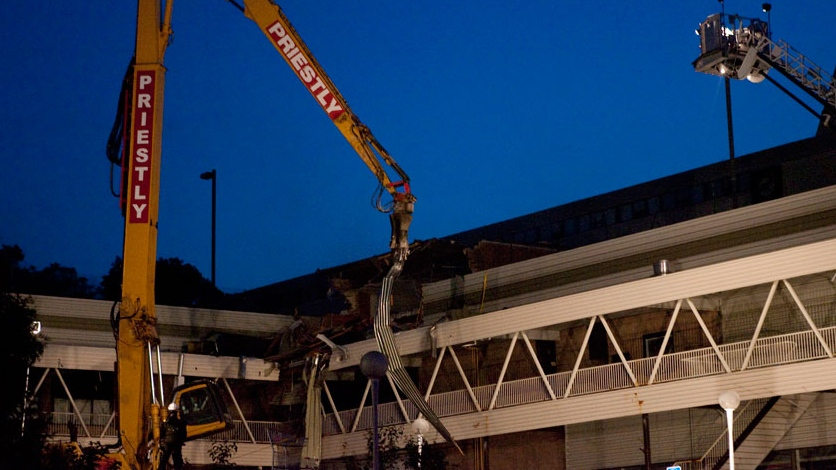 A demolition crane tears part of the Algo Centre Mall in Elliot Lake, Ont. on Tuesday June 26, 2012. (Chris Young / THE CANADIAN PRESS)