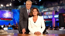 Lisa LaFlamme sits in the anchor's chair next to Lloyd Robertson following the formal announcement naming her as the new anchor for CTV National News, in Toronto, Friday, July 9, 2010.
