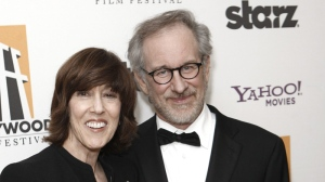 Nora Ephron, left, holds her Screenwriter award as she poses with presenter Steven Spielberg backstage at the 13th Annual Hollywood Awards Gala on Monday, Oct. 26, 2009, in Beverly Hills, Calif. (AP Photo/Matt Sayles)