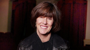 Nora Ephron poses inside the Barrymore Theatre in New York, Dec. 11, 2002. (AP / Gino Domenico)
