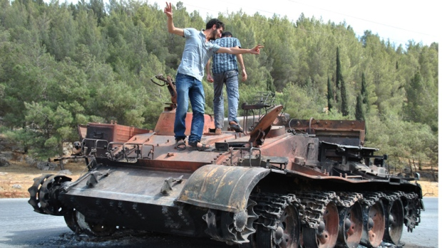 A burned Syrian military tank in Saraqeb town, in the northern province of Idlib, Syria.
