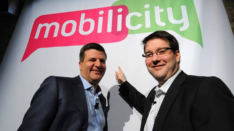 DAVE Wireless becomes Mobilicity: Chairman John Bitove (left) and President Dave Dobbin unveil Mobilicity, the company's go-to-market consumer brand name, at a press conference in Toronto, Tuesday, Feb. 2, 2010. (THE CANADIAN PRESS)