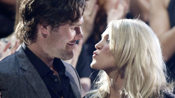 "Carrie Underwood kisses her boyfriend Mike Fisher of the NHL Ottawa Senators as she won ""Video of the Year"" at the 2010 CMT Awards in Nashville, Tenn. Wednesday, June 9, 2010. (AP Photo/M. Spencer Green)"