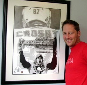 Artist Robb Scott standing next to his sketch of Sidney Crosby raising the Stanley Cup. (Courtesy Robb Scott)