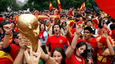 Fans of Spain national soccer team celebrate in Mexico City after their team defeated The Netherlands 1-0 during the South Africa 2010 World Cup final match Sunday, July 11, 2010. (AP / Marco Ugarte)