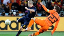 Spain's Andres Iniesta, left, scores a goal past Netherlands' Rafael van der Vaart during the World Cup final soccer match between the Netherlands and Spain at Soccer City in Johannesburg, South Africa, Sunday, July 11, 2010. (AP / Martin Meissner)