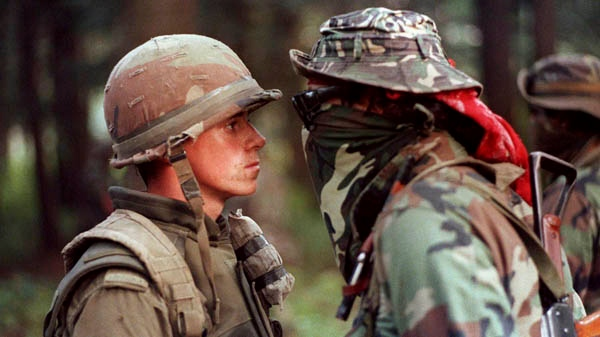 "Canadian soldier Patrick Cloutier and Saskatchewan Native Brad Laroque alias ""Freddy Kruger"" come face to face in a tense standoff at the Kahnesatake reserve in Oka, Quebec, Saturday September 1, 1990. (Shaney Komulainen / THE CANADIAN PRESS)"