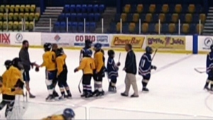 A Vancouver minor hockey coach is seen in this video just before knocking over two young players.