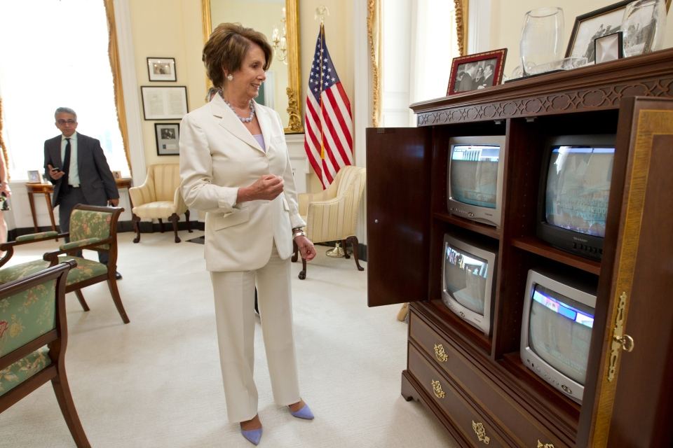 House Minority Leader Nancy Pelosi of Calif., smiles as she watches the breaking news from the Supreme Court which upheld the Affordable Care Act, Thursday, June 28, 2012 on Capitol Hill in Washington.  (AP/ J. Scott Applewhite)