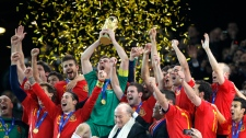 Spain team members celebrate with the World Cup trophy after the World Cup final soccer match between the Netherlands and Spain at Soccer City in Johannesburg, South Africa, Sunday, July 11, 2010. (AP / Frank Augstein)