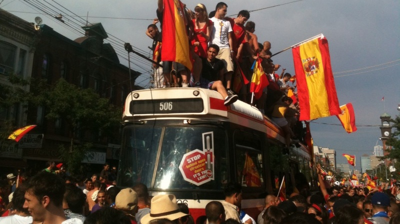 Fans of Spain's national soccer team celebrate the 2010 World Cup victory in the streets of Toronto on Sunday, July 11, 2010. (Bill Doskoch / CTV)