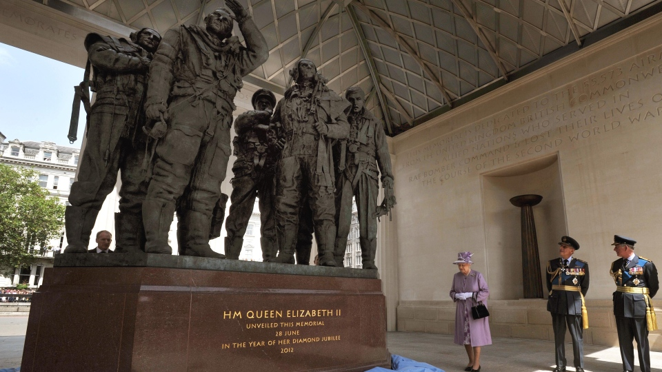 Queen Elizabeth II unveils the Bomber Command Memorial in Green Park, London, watched by Prince Philip, centre, and the Prince Charles, right, Thursday, June 28, 2012. (AP / John Stillwell)