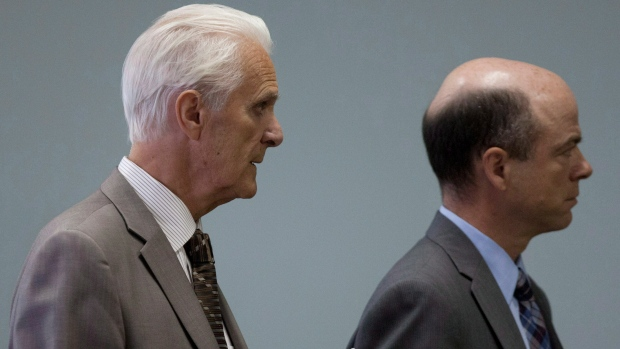 Former Quebec Court judge Jacques Delisle walks to a courtroom with an unidentified person to listen to closing arguments in his trial in Quebec City, on Wednesday, June 6, 2012. (Jacques Boissinot / THE CANADIAN PRESS)