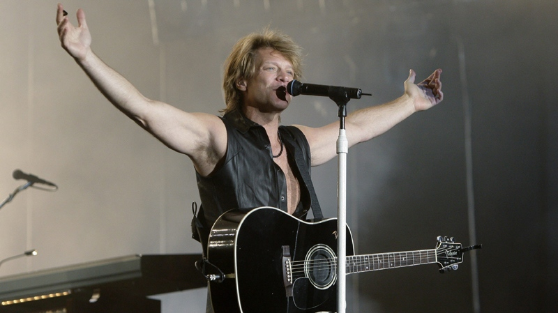 Bon Jovi's lead singer Jon Bon Jovi performs during the Rock in Rio music festival in Arganda del Rey on the outskirts of Madrid Friday June 4, 2010. (AP Photo/Paul White)
