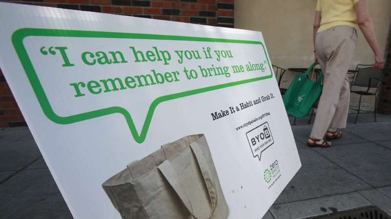 A customer walks into a grocery store in front of an advertising using cloth bags in Palo Alto, Calif., Wednesday, June 2, 2010. (AP Photo / Paul Sakuma)