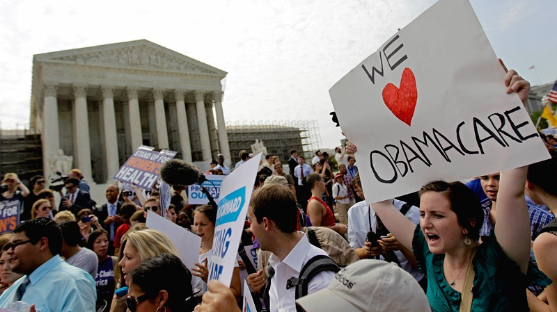 Supporters of President Barack Obama's health care law celebrate outside the Supreme Court in Washington, Thursday, June 28, 2012, after the court's ruling was announced. AP / David Goldman)