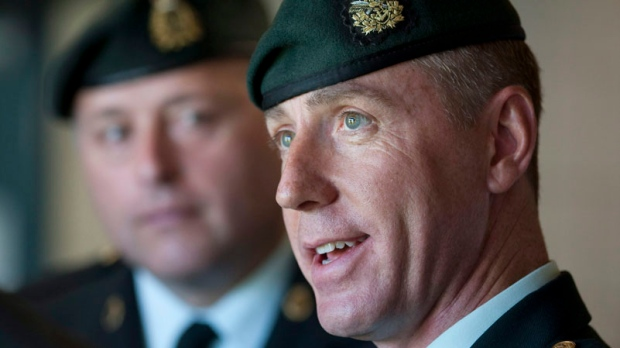 Canada's former top soldier in Kandahar, Brigadier-General Daniel Menard speaks with the media as Lt-Colonel Troy Sweet looks on in Gatineau, Que., Tuesday, May 25, 2010.  (Adrian Wyld / THE CANADIAN PRESS)