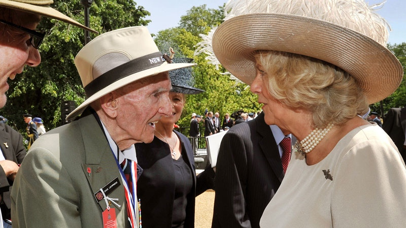 Camilla, the Duchess of Cornwall talks to former airman Dick Lempriere of the NZRAF from New Zealand, after Queen Elizabeth II unveiled the Bomber Command Memorial in Green Park Thursday June 28, 2012. (AP / John Stillwell)