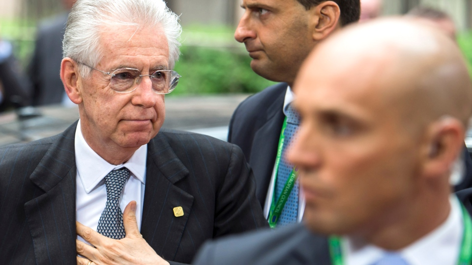 Italian Prime Minister Mario Monti, left, arrives for an EU Summit in Brussels on Friday, June 29, 2012. European leaders have agreed to use the continent's permanent bailout fund to recapitalize struggling banks, and agreed to the idea of a tighter union in the long term. (AP Photo/Geert Vanden Wijngaert)