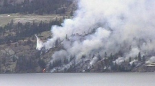 A wildfire burns in Seclusion Bay near Peachland, B.C. July 12, 2010. (CTV)
